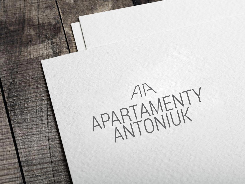 Apartamenty Antoniuk w Białymstoku logo na dokumentach